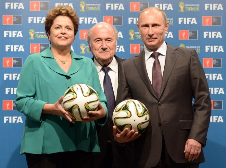 (From L) Brazil's President Dilma Rousseff, FIFA President Joseph Blatter and Russia's President Vladimir Putin pose during handing over of the 2018 FIFA World Cup to Russia on July 13, 2014 in Rio de Janeiro. AFP PHOTO / RIA NOVOSTI POOL / ALEKSEY NIKOLSKYI