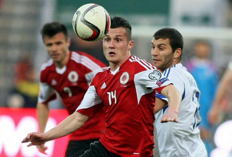 Albania's Taulant Xhaka (L) challenges Armenia's Hovhannes Hambardzumyan during the Euro 2016 group I qualifying football match between Albania and Armenia at Elbasan Arena in Elbasan on March 29, 2015. AFP PHOTO / GENT SHKULLAKU