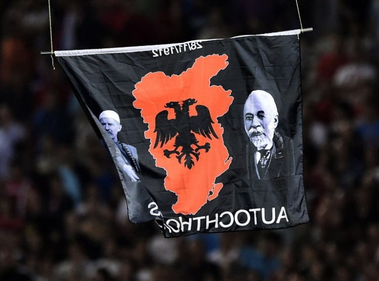A flag with Albanian national symbols attached to a remotely operated drone flies in the stadium during the EURO 2016 group I football match between Serbia and Albania in Belgrade on October 14, 2014. AFP PHOTO / ANDREJ ISAKOVIC