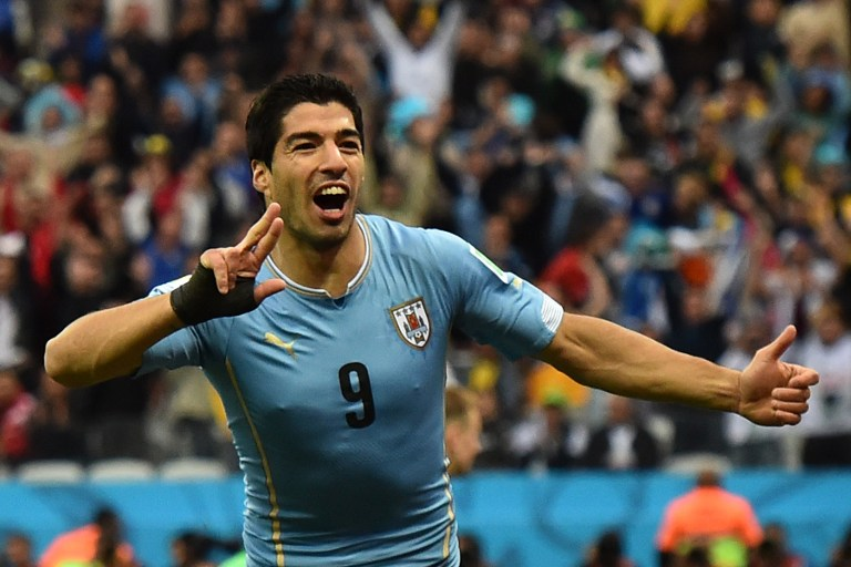 Uruguay's Stürmer Luis Suarez feiert sein Tor gegen Englandam 19.Juni 2014, during the 2014 FIFA World Cup.     AFP PHOTO / BEN STANSALL