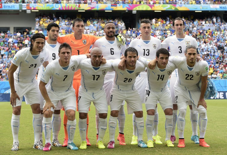 Members of the Uruguay's national team (back fromL) Uruguay's forward Luis Suarez, Uruguay's goalkeeper Fernando Muslera, Uruguay's midfielder Alvaro Pereira, Uruguay's defender Jose Maria Gimenez and Uruguay's defender Diego Godin , (front fromL) Uruguay's forward Edinson Cavani, Uruguay's midfielder Cristian Rodriguez, Uruguay's midfielder Egidio Arevalo Rios, Uruguay's midfielder Alvaro Gonzalez, Uruguay's midfielder Nicolas Lodeiro and Uruguay's defender Martin Caceres pose prior to a Group D football match between Italy and Uruguay at the Dunas Arena in Natal during the 2014 FIFA World Cup on June 24, 2014.   AFP PHOTO/ DANIEL GARCIA