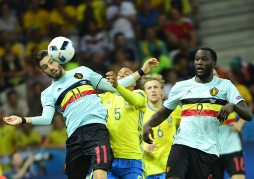 Sweden's defender Martin Olsson (2nd L) vies with Belgium's forward Yannick Ferreira-Carrasco (L) and Belgium's forward Romelu Lukaku during the Euro 2016 group E football match between Sweden and Belgium at the Allianz Riviera stadium in Nice on June 22, 2016. / AFP PHOTO / EMMANUEL DUNAND