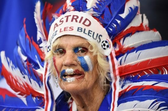 "A France supporter has written ""Astrid"" on her Indian head ornament as she cheers prior to the Euro 2016 group A football match between France and Albania at the Velodrome stadium in Marseille on June 15, 2016. / AFP PHOTO / BERTRAND LANGLOIS"