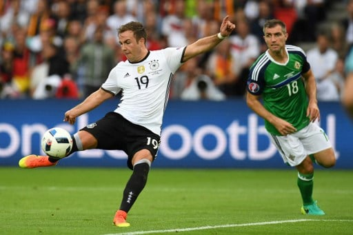 Northern Ireland's defender Aaron Hughes (R) watches as Germany's forward Mario Goetze has an attempt on a goal during the Euro 2016 group C football match between Northern Ireland and Germany at the Parc des Princes stadium in Paris on June 21, 2016. / AFP PHOTO / PATRIK STOLLARZ