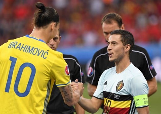 Sweden's forward Zlatan Ibrahimovic (L) shakes hands with Belgium's forward Eden Hazard before the Euro 2016 group E football match between Sweden and Belgium at the Allianz Riviera stadium in Nice on June 22, 2016. / AFP PHOTO / JONATHAN NACKSTRAND
