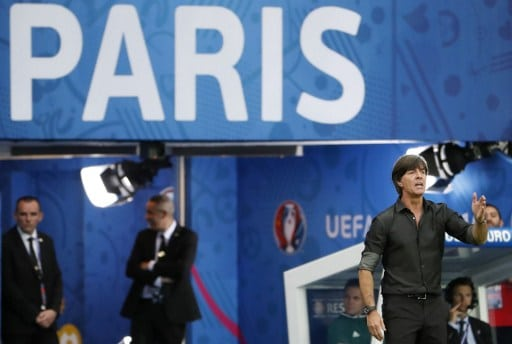 Germany's coach Joachim Loew (R) gestures during the Euro 2016 group C football match between Northern Ireland and Germany at the Parc des Princes stadium in Paris on June 21, 2016. / AFP PHOTO / ODD ANDERSEN