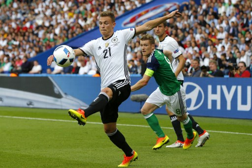Germany's midfielder Joshua Kimmich plays the ball during the Euro 2016 group C football match between Northern Ireland and Germany at the Parc des Princes stadium in Paris on June 21, 2016. / AFP PHOTO / ODD ANDERSEN
