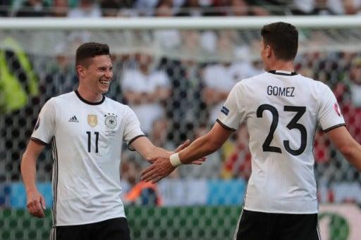 Julian Draxler macht das 3:0 nach Vorlage von Mario Gomez gegen die Slowakei am 26.Juni 2016. / AFP PHOTO / KENZO TRIBOUILLARD