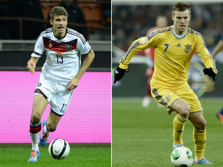 Thomas Mueller und Mittelfeldspieler Andriy Yarmolenko - Kontrahenten und Superstars ihres Teams./ AFP PHOTO / OLIVIER MORIN AND FRANCK FIFE